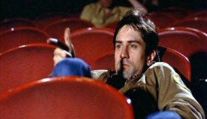 Sitting in a XXX theater, Travis plays out a murderous fantasy he would later fulfill in Martin Scorsese's Taxi Driver.